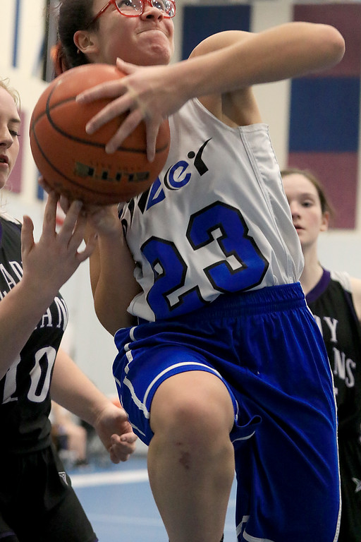 . North Brookfield High School girls basketball played The Sizer School in Fitchburg on Friday afternoon, February 15, 2019. Sizer\'s Elysia Comier puts up a shot. SENTINEL & ENTERPRISE/JOHN LOVE