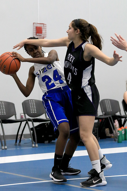 . North Brookfield High School girls basketball played The Sizer School in Fitchburg on Friday afternoon, February 15, 2019. NBHS\'s Sam Rischitelli covers Sizer\'s Odette Amoakohene during the game. SENTINEL & ENTERPRISE/JOHN LOVE