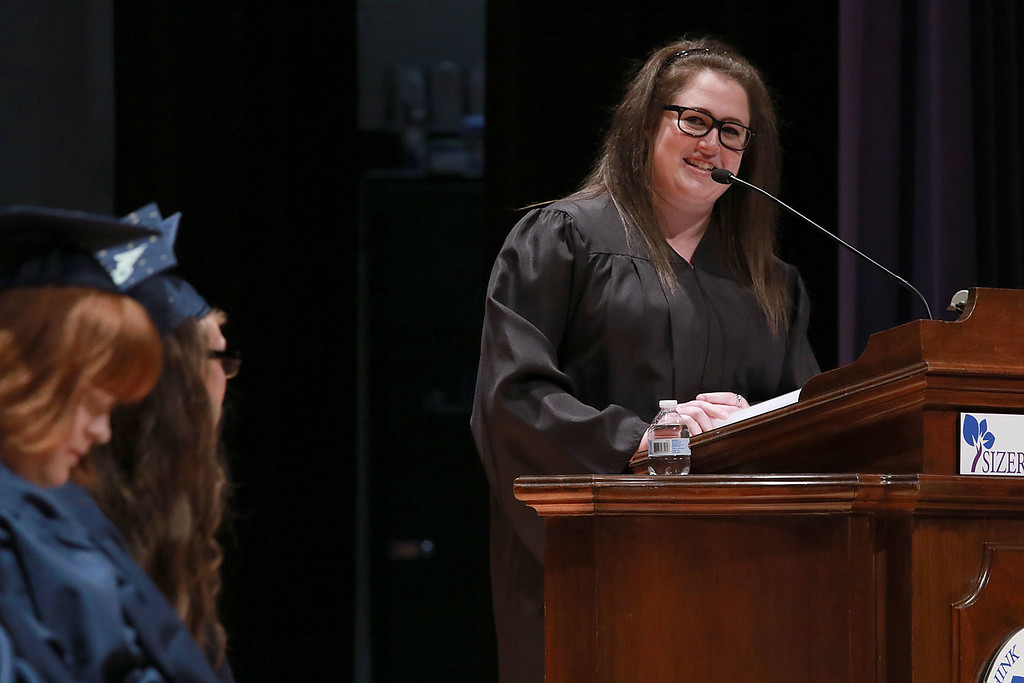 . Scenes from the Sizer School graduation on Tuesday night at Weston Auditorium at Fitchburg State University. Sizer School division 2 English teacher Cassandra Cook addresses the class of 2018 along with their family and friends at the ceremony. SENTINEL & ENTERPRISE/JOHN LOVE