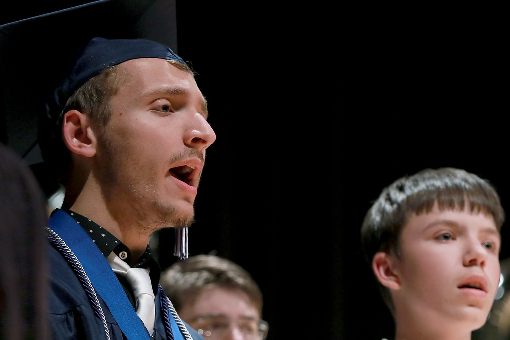 . Scenes from the Sizer School graduation on Tuesday night at Weston Auditorium at Fitchburg State University. Graduate Matthew Marr sings Finale B from the musical RENT with the Sizer Singers during the ceremony. SENTINEL & ENTERPRISE/JOHN LOVE