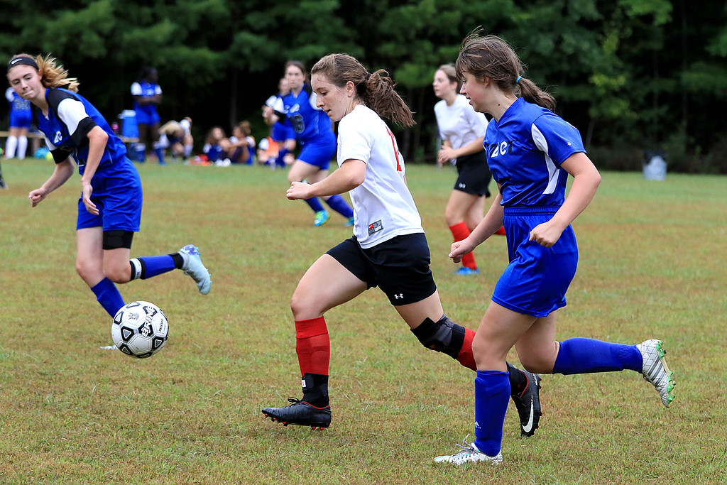 . Sizer School girls soccer played Trivium on Wednesday afternoon at Saima Park in Fitchburg. Trivium\'s Emma Scheurer takes off with the ball followed by Damia Greelish during action in the game. SENTINEL & ENTERPRISE/JOHN LOVE