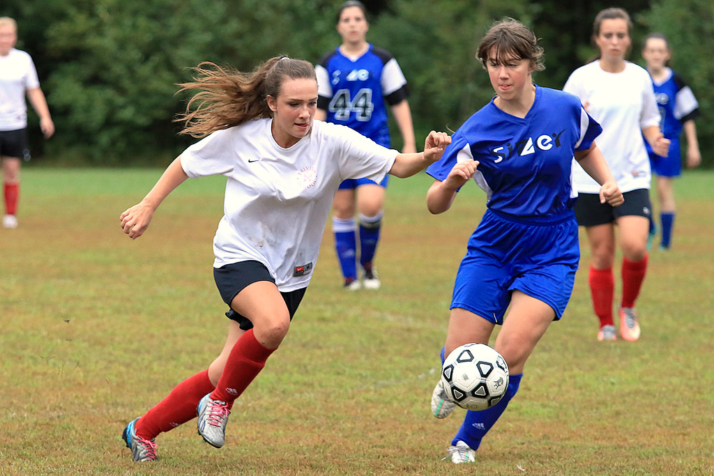 . Sizer School girls soccer played Trivium on Wednesday afternoon at Saima Park in Fitchburg. Trivium\'s Rebecca Dalsass and Sizer\'s Damia Greelish chase after the ball. SENTINEL & ENTERPRISE/JOHN LOVE