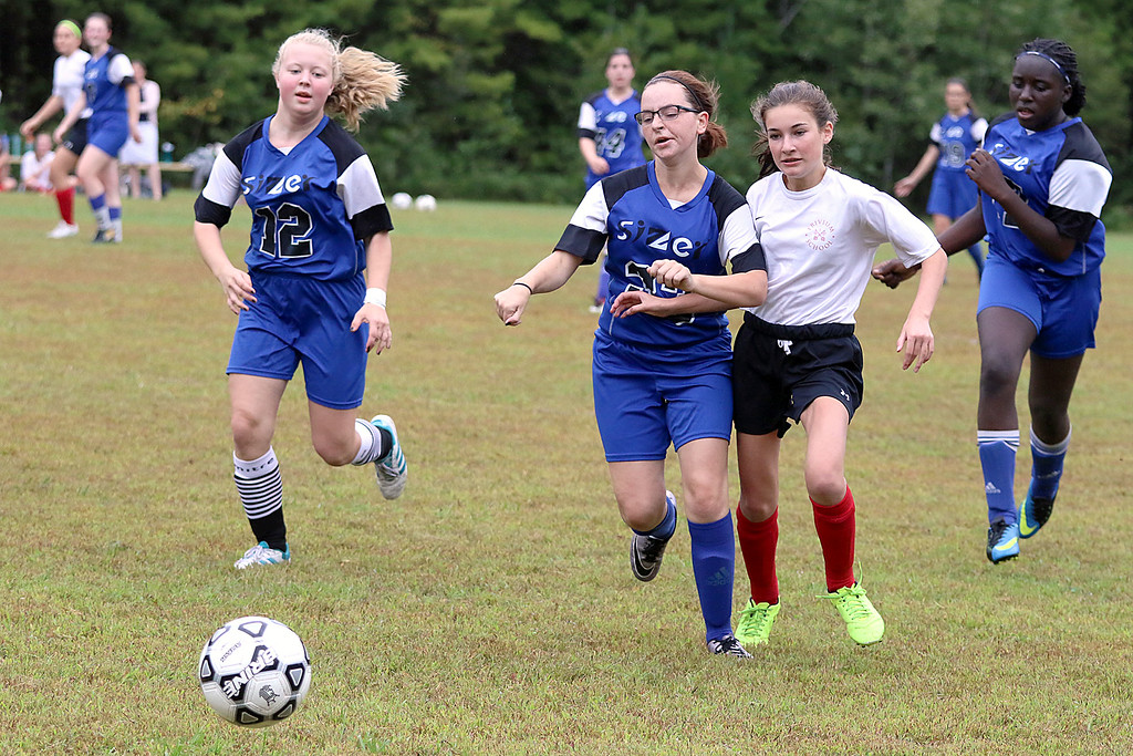 . Sizer School girls soccer played Trivium on Wednesday afternoon at Saima Park in Fitchburg. Sizer\'s Jo-Ann Muldoon and Trivium\'s Marguerite Ortiz chase after the ball during action in the game. SENTINEL & ENTERPRISE/JOHN LOVE