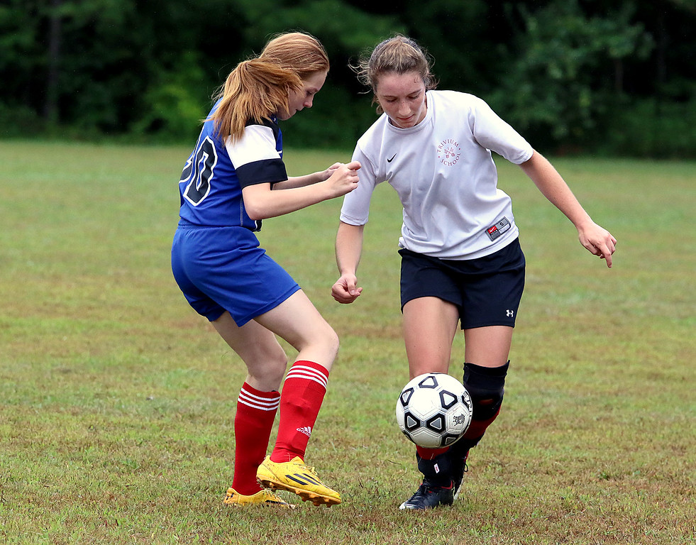 . Sizer School girls soccer played Trivium on Wednesday afternoon at Saima Park in Fitchburg. Sizer\'s Amanda King and Trivium\'s Emma Scheurer fight for control of the ball. SENTINEL & ENTERPRISE/JOHN LOVE