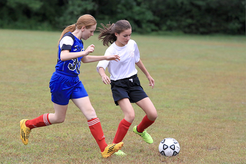 . Sizer School girls soccer played Trivium on Wednesday afternoon at Saima Park in Fitchburg. Trivium\'s player Marguerite and Sizer\'s Amanda King fight for control of the ball during action in the game. SENTINEL & ENTERPRISE/JOHN LOVE