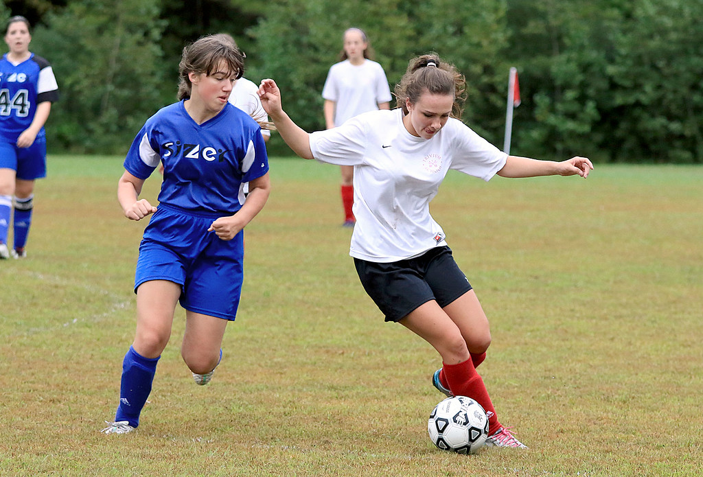. Sizer School girls soccer played Trivium on Wednesday afternoon at Saima Park in Fitchburg. Trivium\'s Rebecca Dalsass controls the ball as Sizer\'s Damia Greelish comes in to stop her. SENTINEL & ENTERPRISE/JOHN LOVE