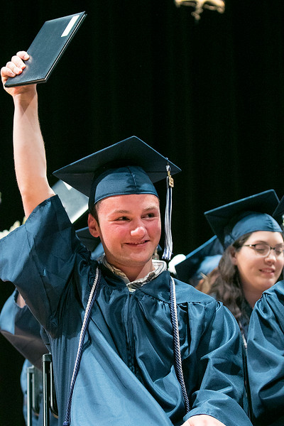 The Sizer A North Central Charter Essential School held their graduation on Thursday night, June 6, 2019 at Fitchburg State University. Graduate Nicco Colecchi proudly holds up his diploma during the ceremony. SENTINEL & ENTERPRISE/JOHN LOVE