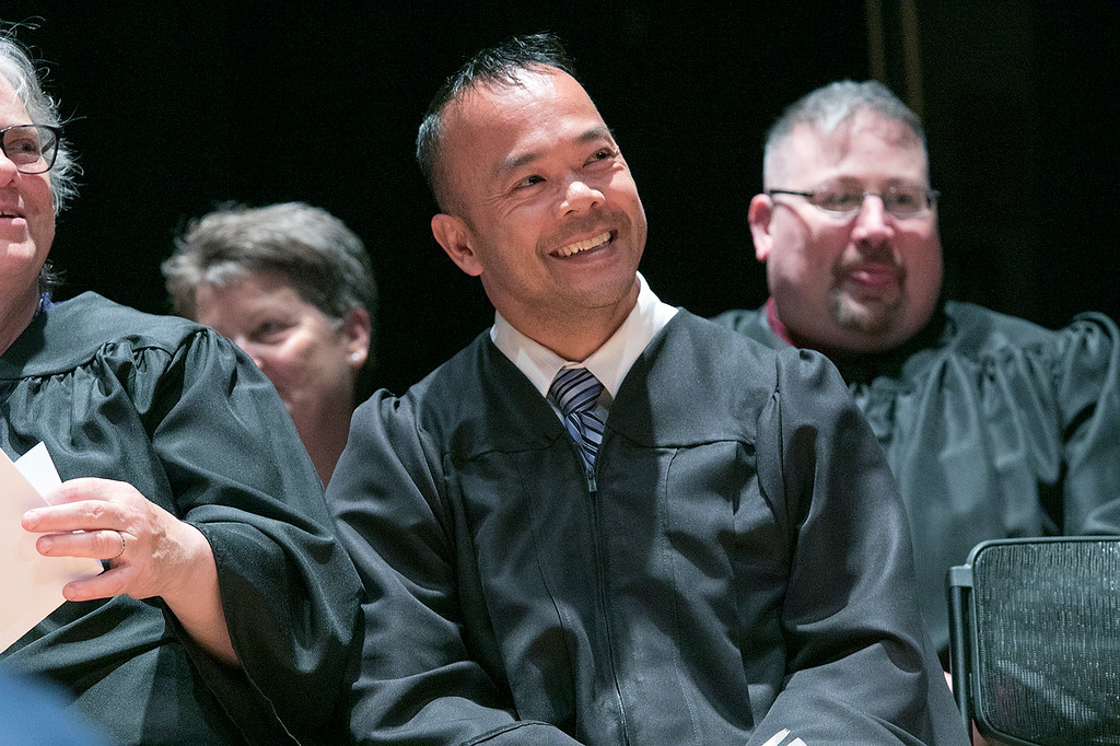. The Sizer A North Central Charter Essential School held their graduation on Thursday night, June 6, 2019 at Fitchburg State University. Senator Dean Tran listens to Fitchburg Mayor Stephen DiNatale as he introduces him as the next speaker. SENTINEL & ENTERPRISE/JOHN LOVE