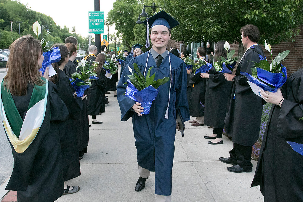 . The Sizer A North Central Charter Essential School held their graduation on Thursday night, June 6, 2019 at Fitchburg State University. The graduates parade through two rows of faculty and staff, were they each got a flower, at the end of the ceremony. SENTINEL & ENTERPRISE/JOHN LOVE
