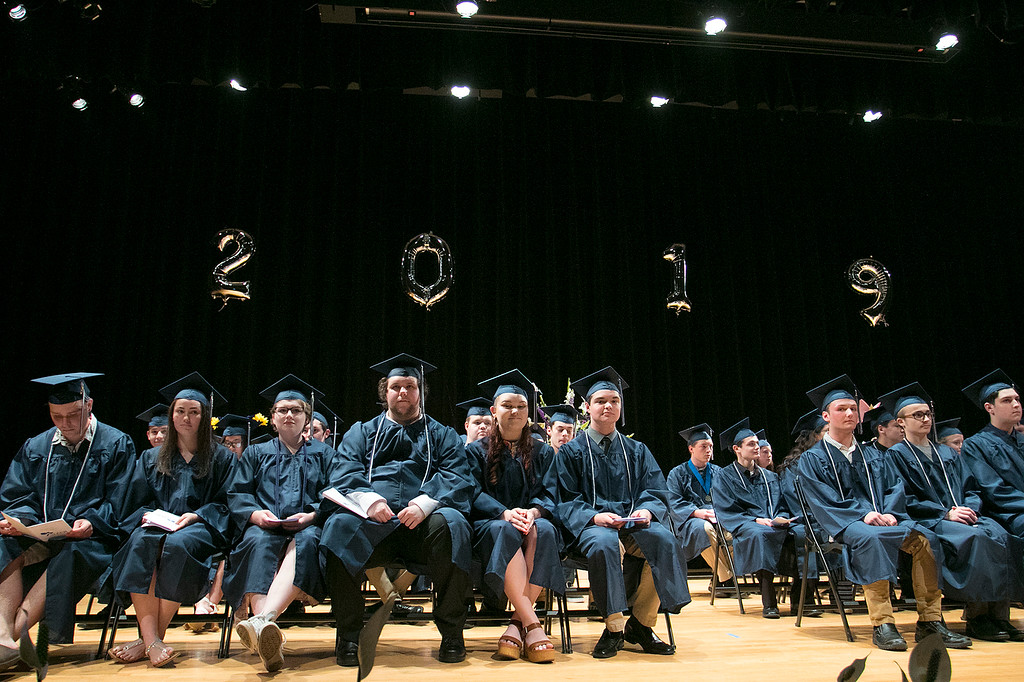 . The Sizer A North Central Charter Essential School held their graduation on Thursday night, June 6, 2019 at Fitchburg State University. The class sits on the stage at the start of the ceremony. SENTINEL & ENTERPRISE/JOHN LOVE