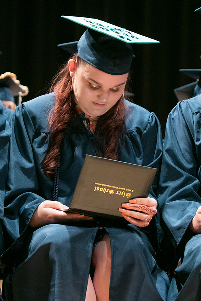 The Sizer A North Central Charter Essential School held their graduation on Thursday night, June 6, 2019 at Fitchburg State University. Madelyn Boire looks at her diploma during the ceremony. SENTINEL & ENTERPRISE/JOHN LOVE