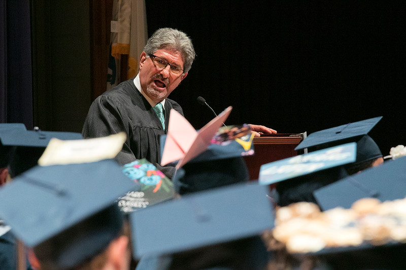 The Sizer A North Central Charter Essential School held their graduation on Thursday night, June 6, 2019 at Fitchburg State University. Fitchburg Mayor Stephen DiNatale addresses the crowd at the ceremony. SENTINEL & ENTERPRISE/JOHN LOVE