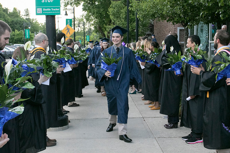 The Sizer A North Central Charter Essential School held their graduation on Thursday night, June 6, 2019 at Fitchburg State University. The graduates parade through two rows of faculty and staff, were they each got a flower, at the end of the ceremony. SENTINEL & ENTERPRISE/JOHN LOVE