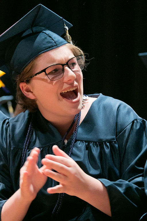 . The Sizer A North Central Charter Essential School held their graduation on Thursday night, June 6, 2019 at Fitchburg State University. Graduate Mackenzie Breen cheers for her classmates during the ceremony. SENTINEL & ENTERPRISE/JOHN LOVE