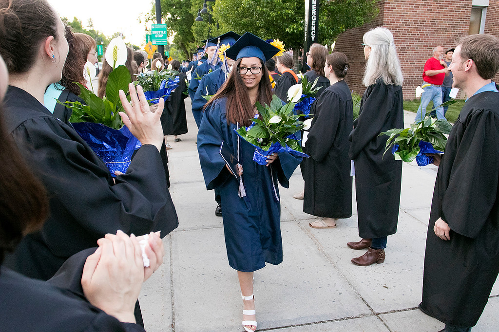 . The Sizer A North Central Charter Essential School held their graduation on Thursday night, June 6, 2019 at Fitchburg State University. Graduate Namomi Matta-Paskell parades through two rows of faculty and staff, were each graduate got a flower, at the end of the ceremony. SENTINEL & ENTERPRISE/JOHN LOVE