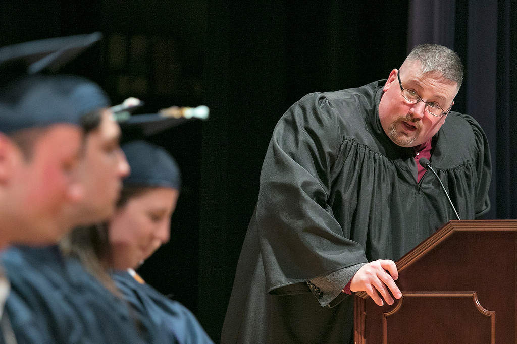 . The Sizer A North Central Charter Essential School held their graduation on Thursday night, June 6, 2019 at Fitchburg State University. Principal Frederick Randall addresses the class during the ceremony. SENTINEL & ENTERPRISE/JOHN LOVE