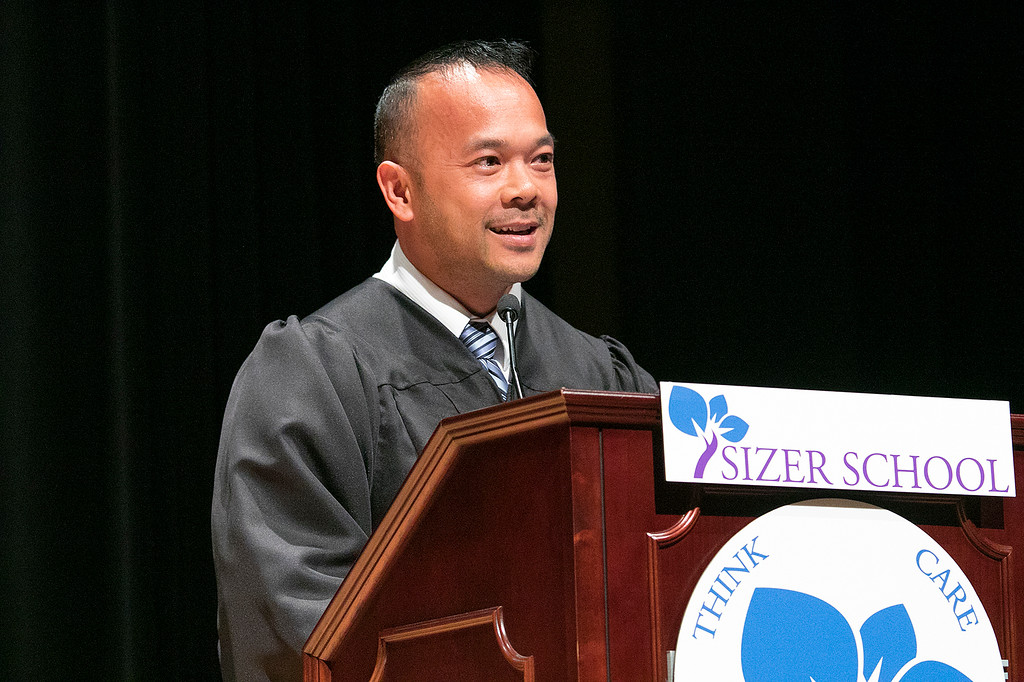 . The Sizer A North Central Charter Essential School held their graduation on Thursday night, June 6, 2019 at Fitchburg State University. Senator Dean Tran addresses the crowd at the ceremony. SENTINEL & ENTERPRISE/JOHN LOVE