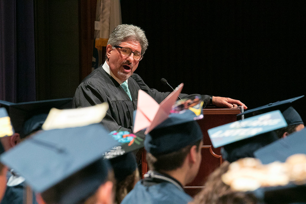 . The Sizer A North Central Charter Essential School held their graduation on Thursday night, June 6, 2019 at Fitchburg State University. Fitchburg Mayor Stephen DiNatale addresses the crowd at the ceremony. SENTINEL & ENTERPRISE/JOHN LOVE