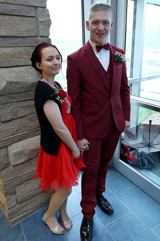 . Scenes from the Sizer School Prom on Saturday, May 19, 2018. Breanna Mitchell and Nate Phillips wait for friends to arrive at the prom. SENTINEL & ENTERPRISE/JOHN LOVE