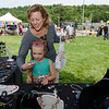 Tricia May and granddaughter Molly O'Dell, 6, check out the jewelry selection from Bead-A-Bit during the Sizer School summer celebration and class car show on Saturday afternoon. SENTINEL & ENTERPRISE / Ashley Green
