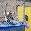 Teacher Duncan Devlin gets dunked during the Sizer School summer celebration and class car show on Saturday afternoon. SENTINEL & ENTERPRISE / Ashley Green