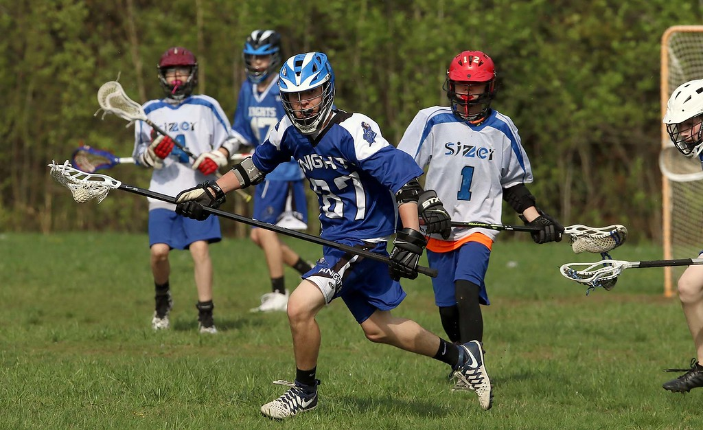 . Lunenburg Middle High School player Robby Nash takes off with the ball during action in their game against the Sizer Charter School in Fitchburg on Thursday afternoon. SENTINEL & ENTERPRISE/JOHN LOVE