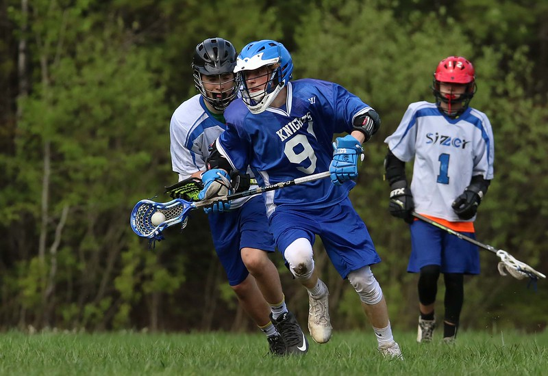 Lunenburg Middle High School player Patrick Favreau takes off with the ball during action in the game against the Sizer School on Thursday afternoon in Fitchburg. Following close behind him is Sizer player Camden Sullivan. SENTINEL & ENTERPRISE/JOHN LOVE