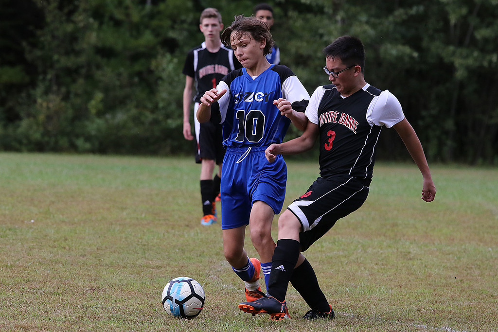 . Notre Dame Prep played Sizer School in Fitchburg on Tuesday, September 11, 2018. Sizer\'s Walker Peters and Beusau Cao fight for control of the ball. SENTINEL & ENTERPRISE/JOHN LOVE