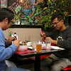 Diners Matt Delorie of Ayer, on left, and Sopol Phan of Lowell enjoy their meal of mussels at the Sizzling Kitchen in Lowell on Merrimack Street. Delorie was having linguini and mussels and Phan was having the dish Mussells Fra Diavolo. SUN/JOHN LOVE
