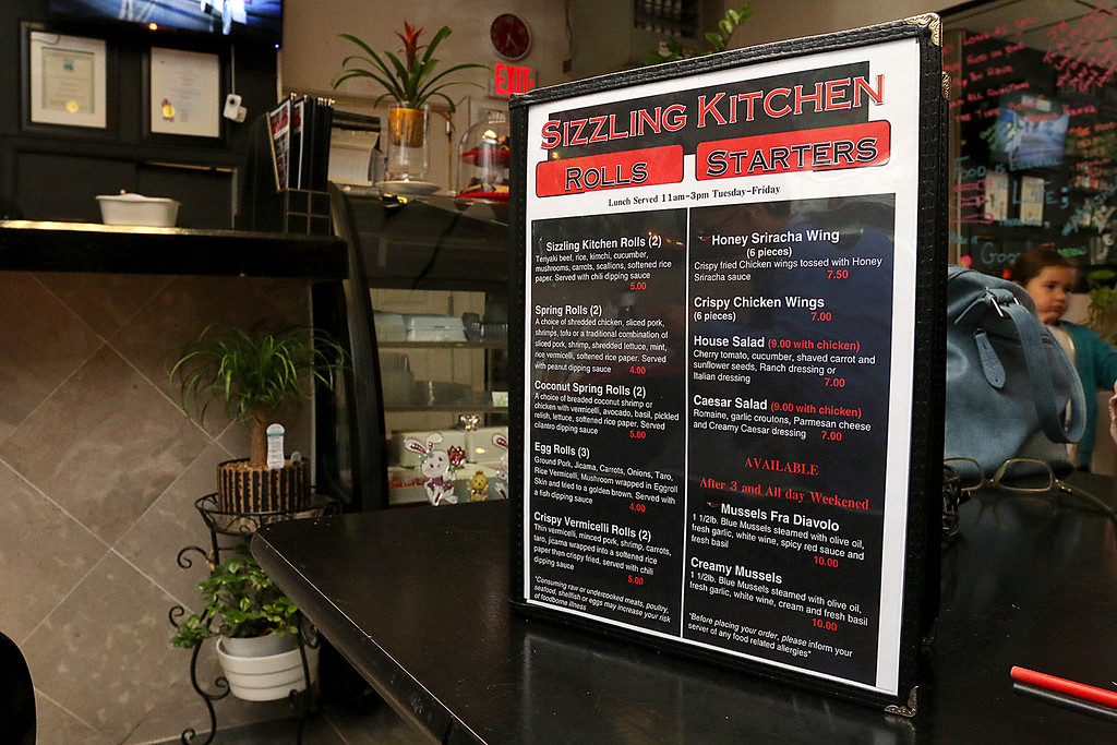 . The menu at the Sizzling Kitchen in Lowell on Merrimack Street. SUN/JOHN LOVE