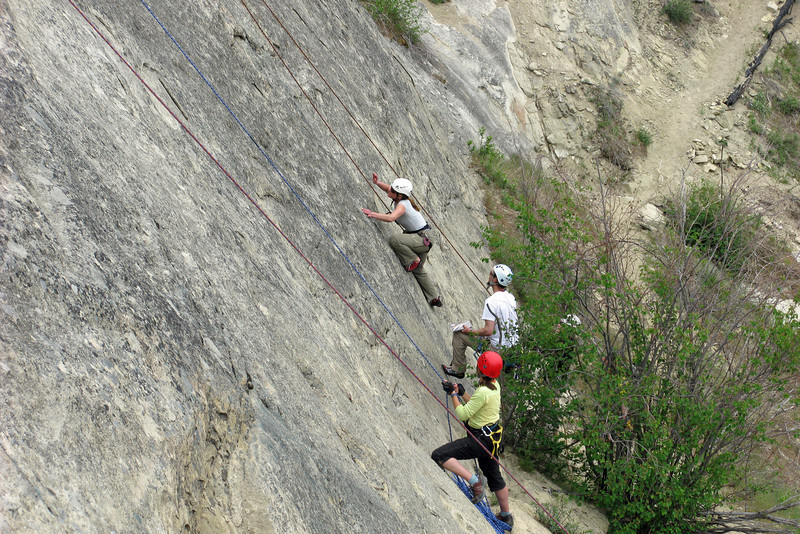 Andrea trying a harder section.  Julie belaying.
