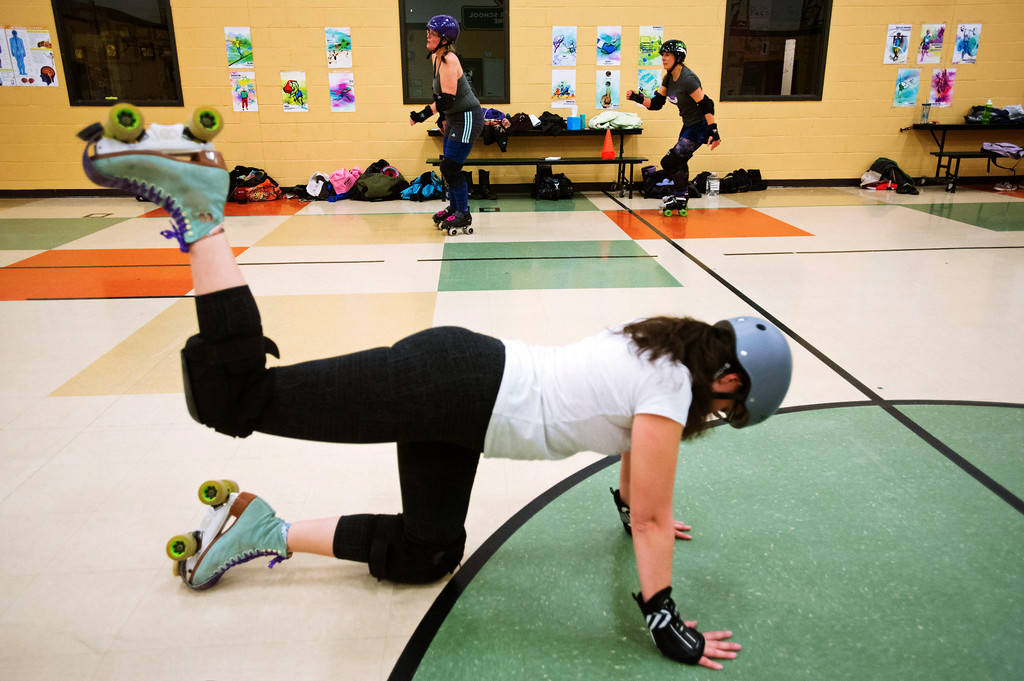 . F0215SKATEFIT10 Jessica Gravel of Longmont does donkey kicks while others skate laps during a Skate Fit event at Imagine Charter School in Firestone on Thursday February 2, 2017.  Photo by: Jonathan Castner