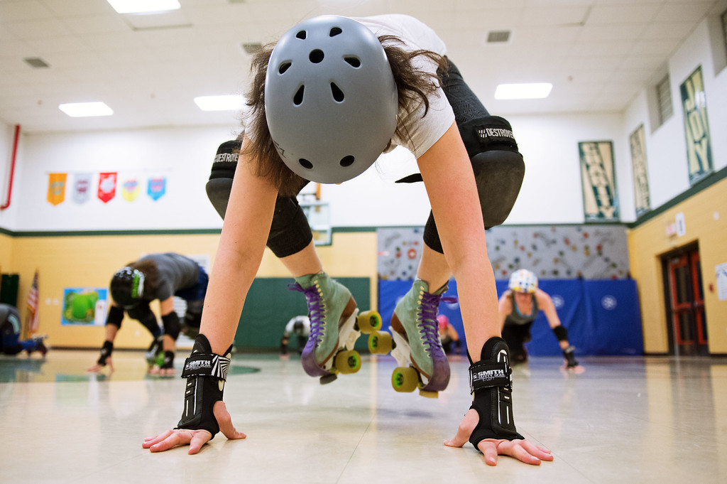 . F0215SKATEFIT1 Jessica Gravel of Longmont does Burpees during a Skate Fit event at Imagine Charter School in Firestone on Thursday February 2, 2017.  Photo by: Jonathan Castner