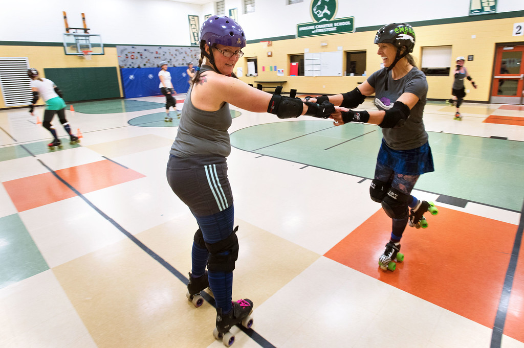 . F0215SKATEFIT7 L-R: Erika Degreene and Vickie Parker during a Skate Fit event at Imagine Charter School in Firestone on Thursday February 2, 2017.  Photo by: Jonathan Castner