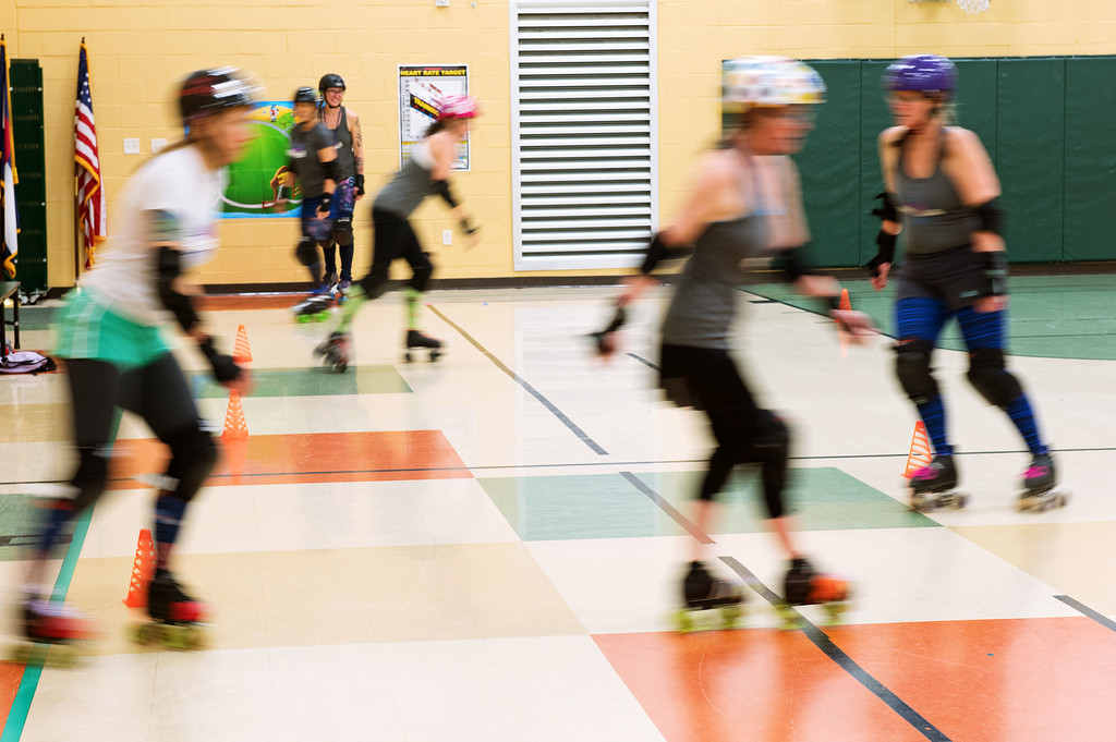 . F0215SKATEFIT3 Attendees run through a slalom during a Skate Fit event at Imagine Charter School in Firestone on Thursday February 2, 2017.  Photo by: Jonathan Castner