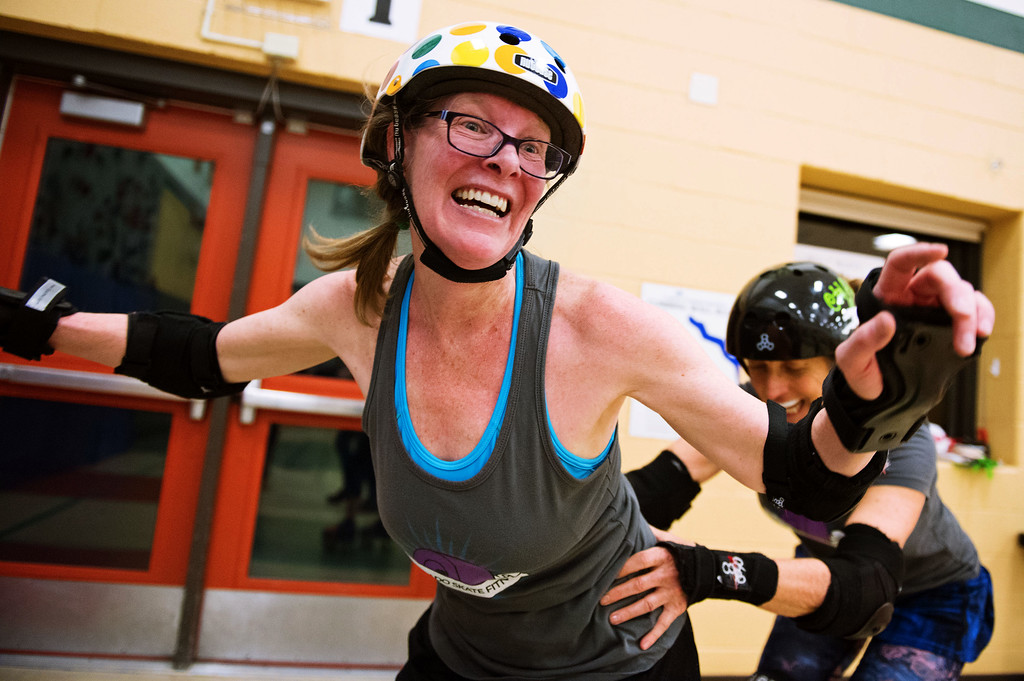 . F0215SKATEFIT5 L-R: Dorothy Vernon and Vickie Parker during a Skate Fit event at Imagine Charter School in Firestone on Thursday February 2, 2017.  Photo by: Jonathan Castner