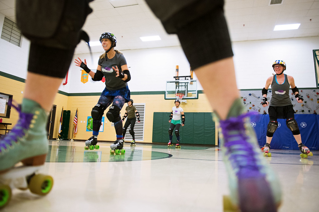 . F0215SKATEFIT2 L-R: Vickie Parker, Megan Amaral, Julia O\'Sillivan and Dorothy Vernon during a Skate Fit event at Imagine Charter School in Firestone on Thursday February 2, 2017.  Photo by: Jonathan Castner