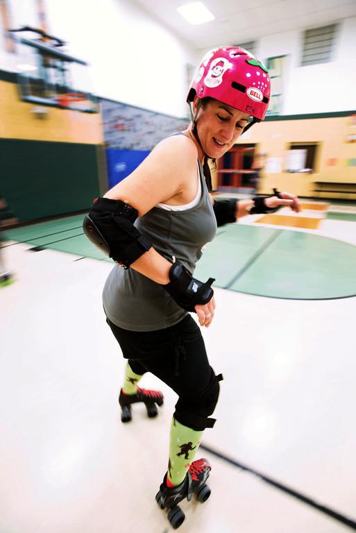 . F0215SKATEFIT8 Lisa Kvasnicka of Superior skates backawards through a slalom during a Skate Fit event at Imagine Charter School in Firestone on Thursday February 2, 2017.  Photo by: Jonathan Castner