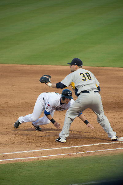 Sugar Land Skeeters Bubba Bell dives safely back to First Base.  Game 2