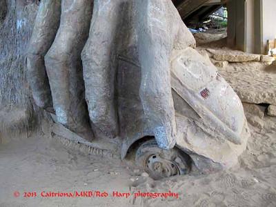 Fremont Troll under the Aurora Bridge.  Troll holds a VW bug