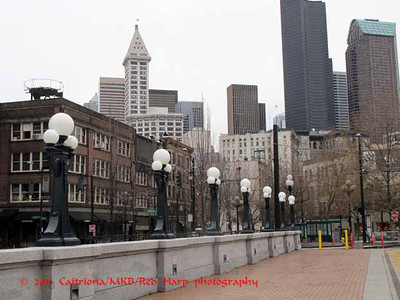 view from King St. Station across the patio with Smith Tower on left