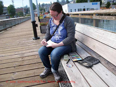"Chandler O'Leary sketching; she is the creator and artist for the ""Droplets"" installation"