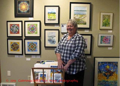 I posed Judi next to her work in a co-op gallery.