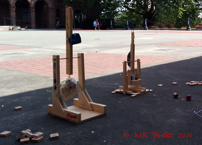 "trebuchets built by children in the special day camp with ""Dr. Wizard""."