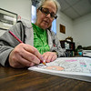 KRISTOPHER RADDER — BRATTLEBORO REFORMER<br /> Joanne Leveille, of Vernon, works on coloring a picture of doughnuts in a book during Adult Coloring Club at Vernon Free Library on Monday, Jan. 13, 2020.