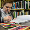 KRISTOPHER RADDER — BRATTLEBORO REFORMER<br /> Elaine Dietrich, of Vernon, works on coloring a picture of doughnuts in a book during Adult Coloring Club at Vernon Free Library on Monday, Jan. 13, 2020.