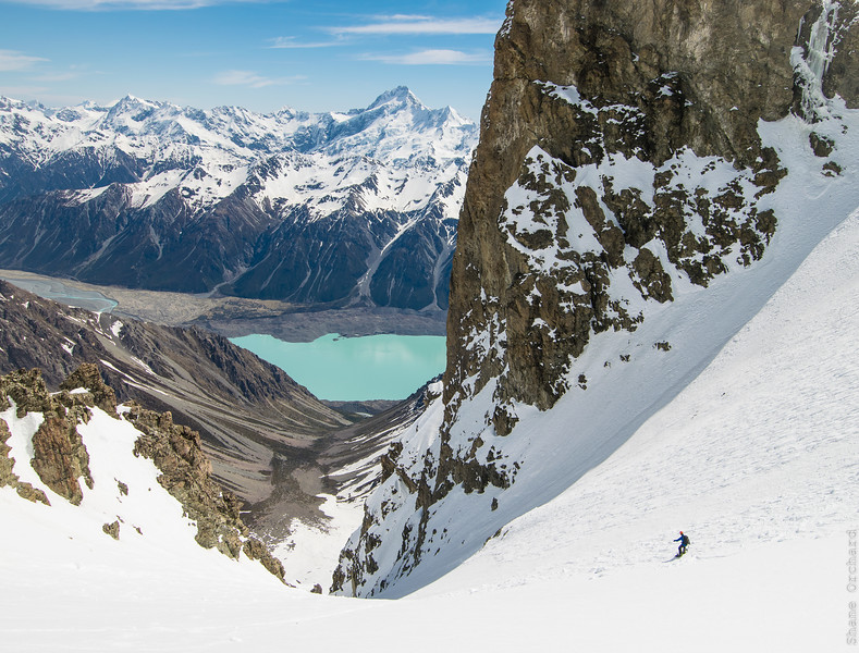 Dropping into Turner's Couloir, a local classic. Tasman lake and Mt Sefton beyond.