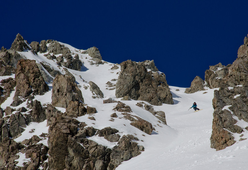 Tess riding off Cow Peak