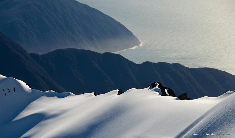 Snow and sea juxtaposition<br /> Fiordland, NZ