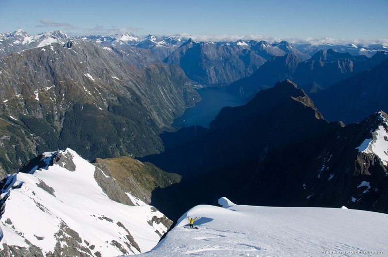 Ruari in the moment after riding the upper glacier, Milford Sound beyond